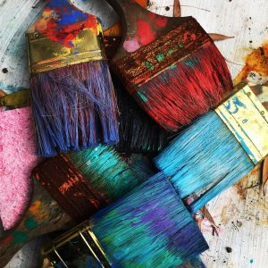 Brightly colored paint brushes