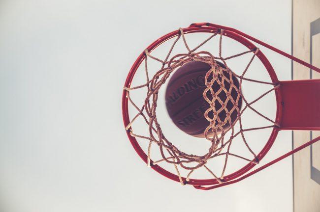 A basketball going through a hoop