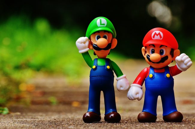 Two small Mario characters