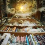 Picture of library books on shelves leading to celestial sky.