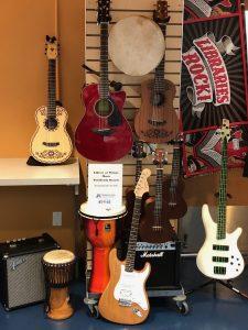 Ukuleles and other instruments on racks