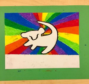 An outline of Simba against a rainbow backdrop.