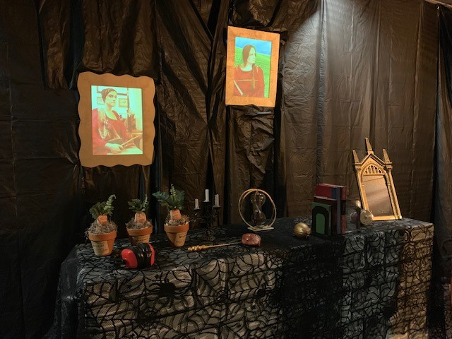 Homemade moving portraits, mandrakes, Sorcerer's Stone, time turner, dragon egg & sneakoscope for use in the Escape Room