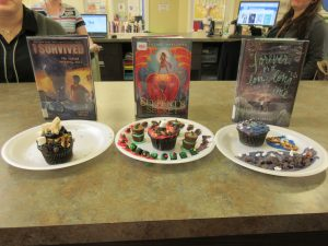 Results of cupcake wars. 3 decorated cupcakes are featured in front of 3 books (I Survived, The Serpent's Secret and Forever, or a Long Time)