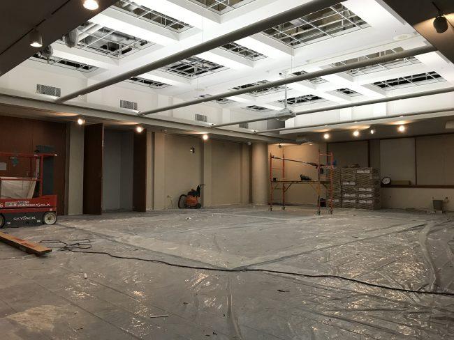 Auditorium space with construction equipment