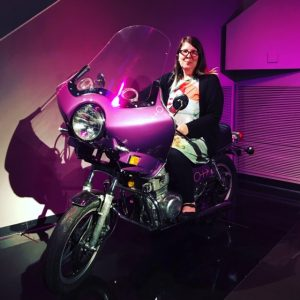 Amber Creger posing on a Prince Motorcycle