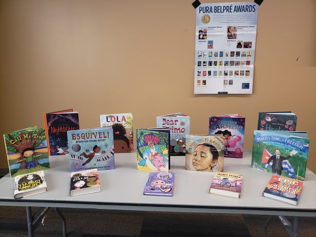 Image with books by Latinx authors
