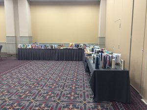 Books under consideration on table in the back of the room