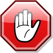 red octagon with hand raised palm up in stop gesture