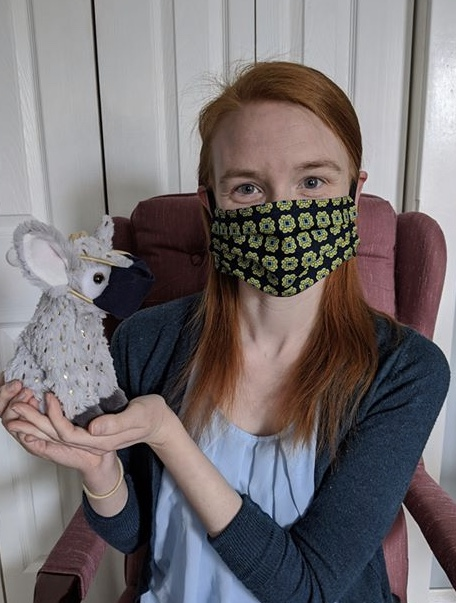 Librarian Claire Petri at Woodlawn Library in Delaware, and her stuffed friend Sparkle, wear masks during a virtual storytime to address the fear kids might have