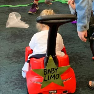 """When advocacy was easy: A toddler rides a push car labeled """"Baby Limo"""""""