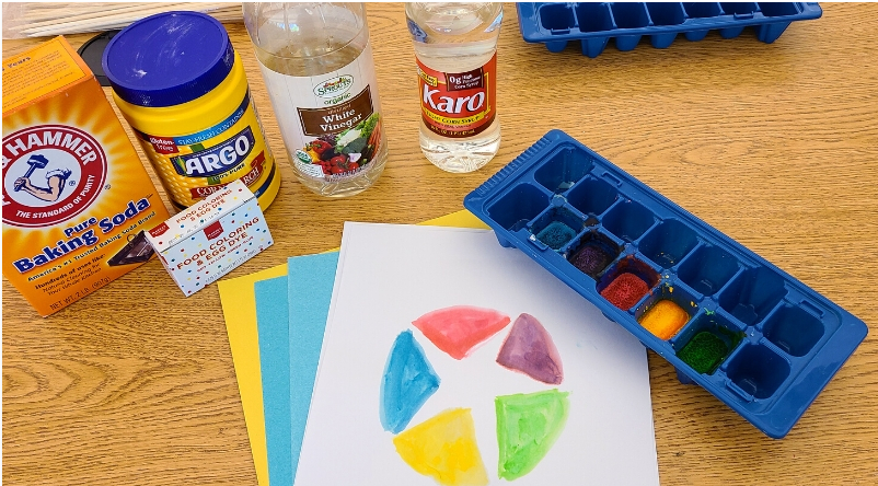 Craft supplies for homemade watercolors arranged on a table
