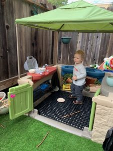 Young friend in outdoor playhouse