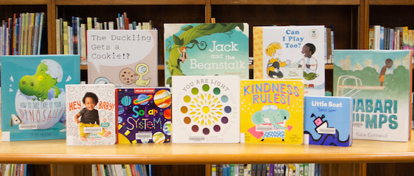 A photo of one of our Book Care Packages showing a selection of board books and picture books for a young reader