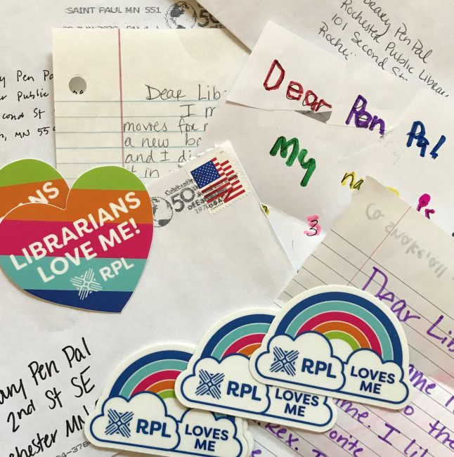 Colorful collage of Pen Pal letters & envelopes with RPL custom stickers shaped like hearts and rainbows.
