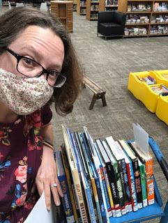 Abby Johnson, collection development librarian, pulls books for patrons!