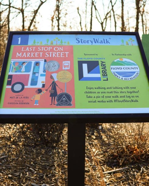 A photo of our StoryWalk showing the cover of our current book, Last Stop on Market Street.