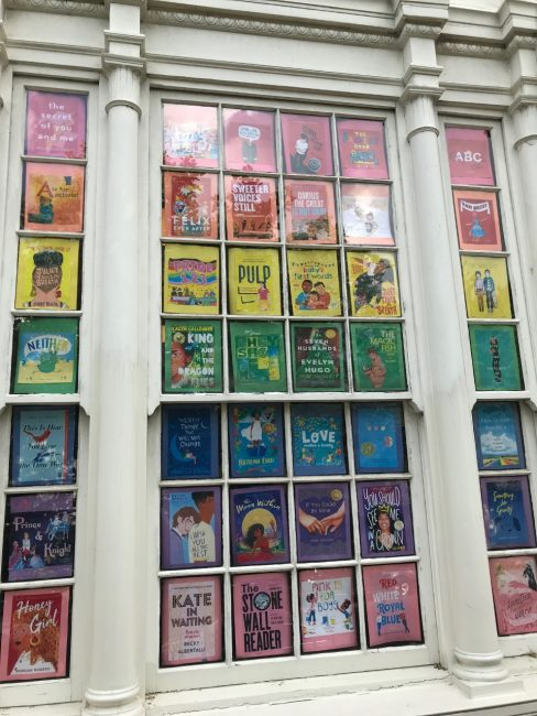 Picture of window display for pride, rainbow book covers.