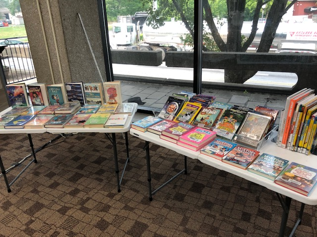 Two of our display tables that held books for children to browse during summer reading under construction.