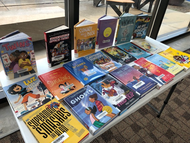 Our graphic novel table, displaying a variety of graphic novels for children to browse during summer reading under construction.