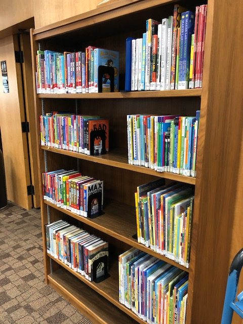 The overflow bookshelf that held additional titles for families to browse during summer reading under construction.