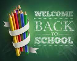 welcome back to school chalk letters on green background combined with bundle of colored pencils wrapped in white ribbon